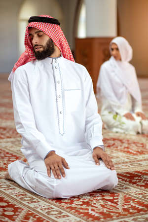 Muslim Praying man and woman in mosque Stock Photo