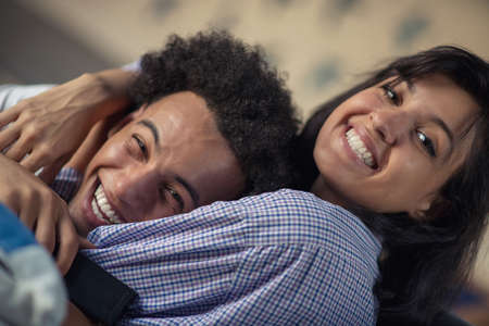 Cropped shot of a young african american couple watching television at home Stock Photo