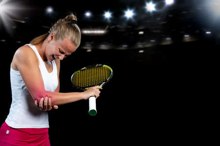 tennis woman player with injury holding the racket on a tennis court. Stock Photo