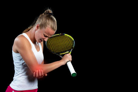 tennis woman player with injury holding the racket on a tennis court