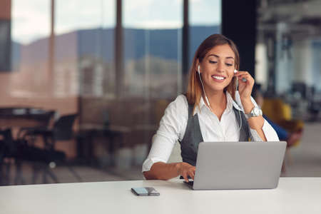 Modern business woman in the office working at computer