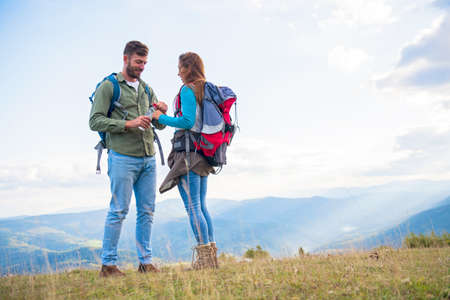Young couple taking a break on a hike. Banco de Imagens