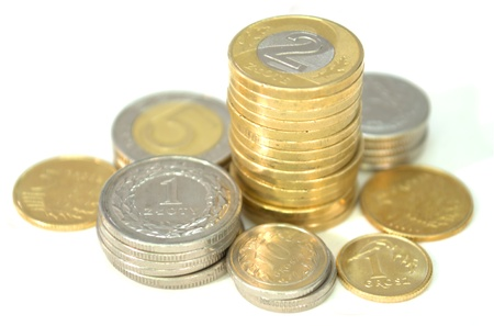 Polish coins creating small towers, perfect for icons or graphs.