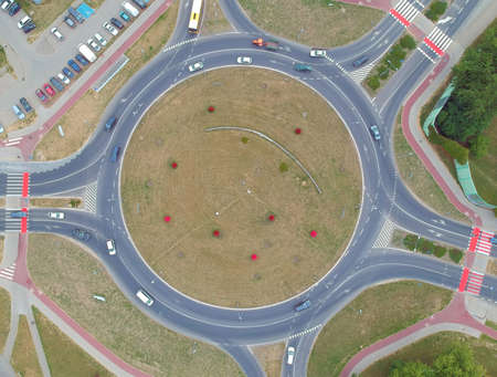 Roundabout intersection in five directions with island, aerial view.