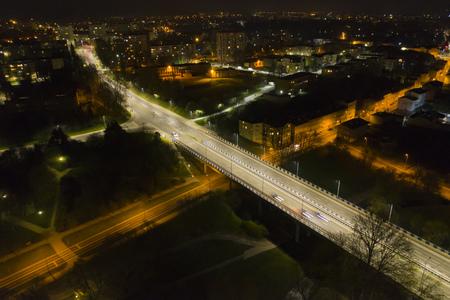KOSZALIN, POLAND - 07 APRIL 2019 - Aerial view on Koszalin city at night with street lights, area of Monte Cassino street bridge and Batalionow street.