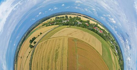 Aerial drone 180 degree panoramic view on damaged wheat field after wind storm, rural landscape.