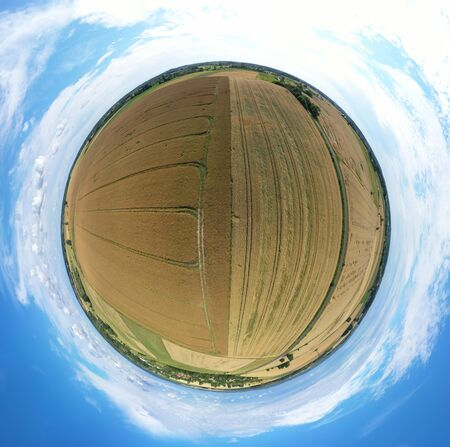 Aerial drone 360 degree panoramic view on damaged wheat field after wind storm, rural landscape. Zdjęcie Seryjne