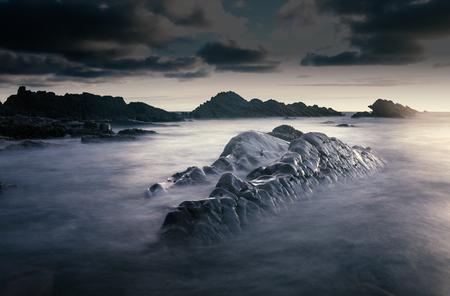 Bude, Cornwall, United Kingdom at sunset, beautiful seascape, sea crashing against rocks