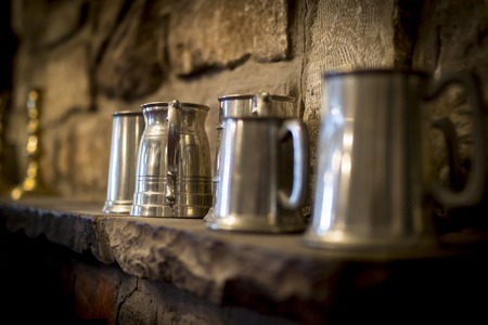 Traditional pewter tankard in a traditional English pub