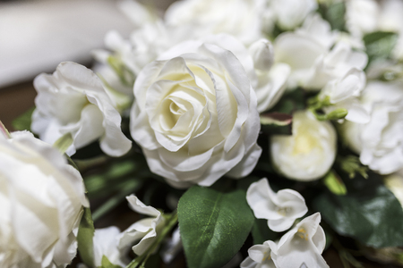 White roses wedding bouquet of flowers shot close up with a shallow depth of field at a tradtional English Wedding in the UK Stock Photo