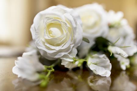 White roses wedding bouquet of flowers shot close up on a wooden stock photo white roses wedding bouquet of flowers shot close up on a wooden table with a shallow depth of field at a tradtional english wedding in the uk mightylinksfo