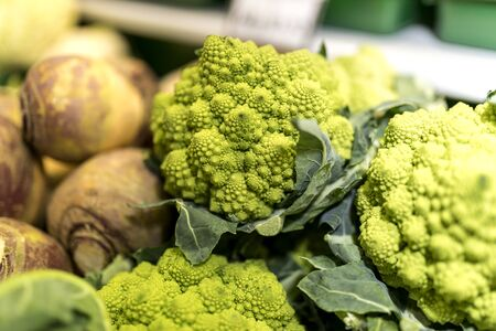 romanesco: Close up of ripe and vibrant green Romanesco and swede vegetables on a market stall in Yorkshire, UK Stock Photo