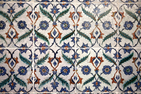Ancient tile pattern on ceramic wall in Topkapi Palace in Istanbul, Turkey photo
