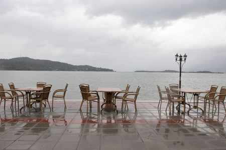 on the beach in rainy, empty Cafe photo