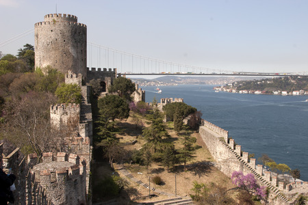 hisari: Rumelihisari with the Fatih Sultan Mehmet Bridge in the background in Istanbul, Turkey Editorial