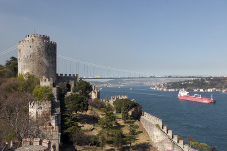 hisari: Rumelihisari with the Fatih Sultan Mehmet Bridge in the background in Istanbul, Turkey Editorial