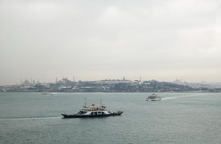 seaway: The Bosphorus maritime traffic on a snowy day in Istanbul,Turkey