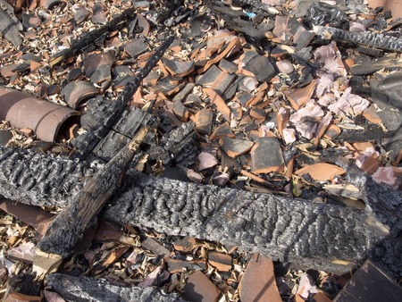 remains: charred ruins and remains of a burned down house