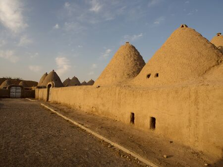 Traditional beehive mud brick desert houses, Harran near the Syrian border, Turkey Stock Photo