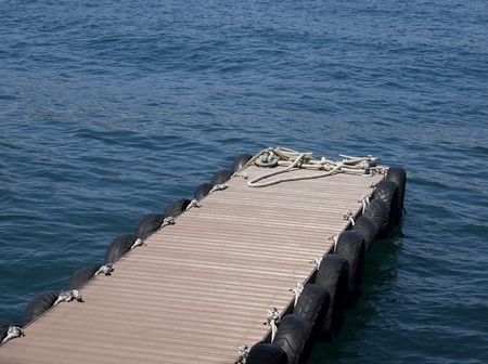 an empty sea wharf and ropes
