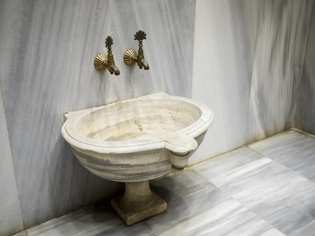 marbled effect: tabs and a marble basin in a turkish bath,Turkey
