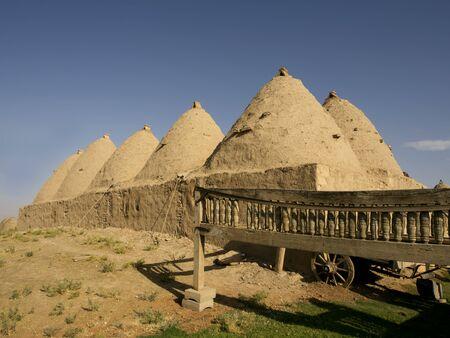 mesopotamian: Traditional beehive mud brick desert houses, Harran near the Syrian border, Turkey Stock Photo