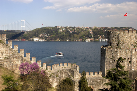 rumeli: Rumelihisari with the Fatih Sultan Mehmet Bridge in the background in Istanbul, Turkey Stock Photo
