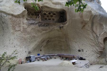 troglodyte: Old troglodyte house cafe in hidden valley , Cappadocia, Turkey Stock Photo