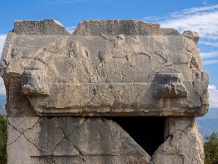 The beautiful lycian carved stone tomb located on the hill of ancient city Xanthos, Turkey