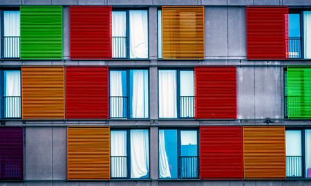 window blinds: Colorful Window Blinds on Building Fasade Stock Photo