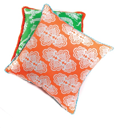 throw cushion: decorative orange and green pillows isolated on white background
