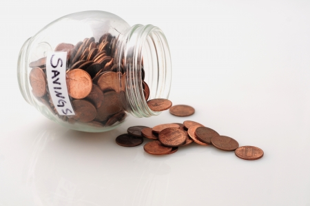 A concept image of jar with pennies to signify saving money or saving pennies photo