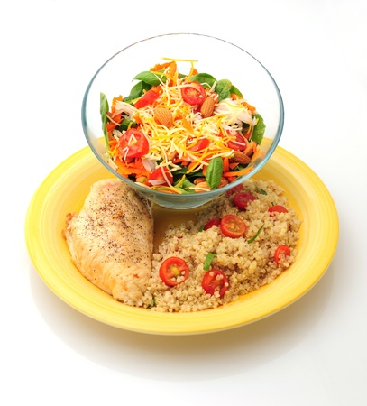 Healthy lunch or dinner with grilled chicken, quinoa and a salad on white background photo