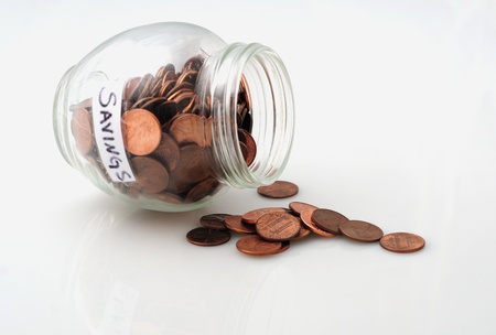 pennies: Pennies spilling out of a jar of pennies to signify dipping into savings