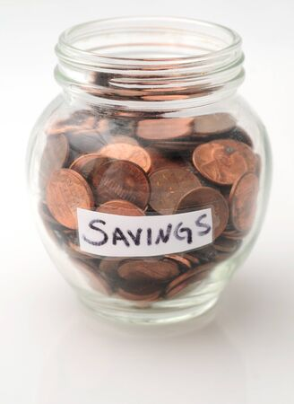 pennies: Saving pennies in a jar of pennies for saving money Stock Photo