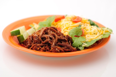 Healthy meal with shredded beef and a salad with cheese and vegetables
