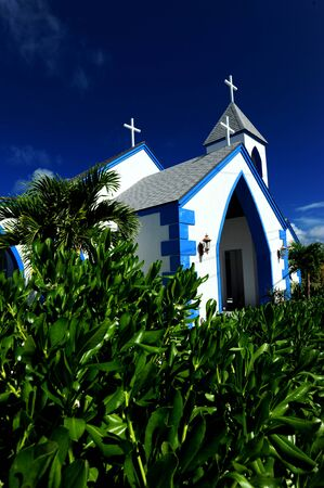 Blue and white church in tropical climate in the Bahamas photo