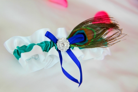 Sexy garter with peacock feather and diamonds Stock Photo
