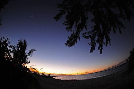 Tropical beach destination at night with fish eye lense Stock Photo