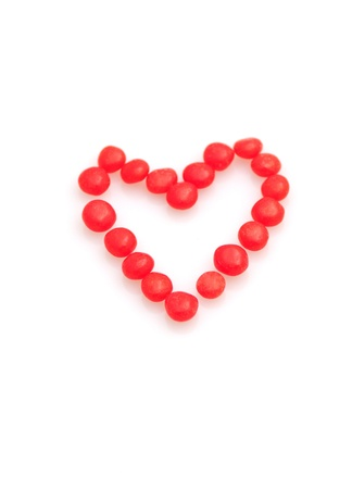 hots: Heart made from red hots isolated on white for Valentines Day