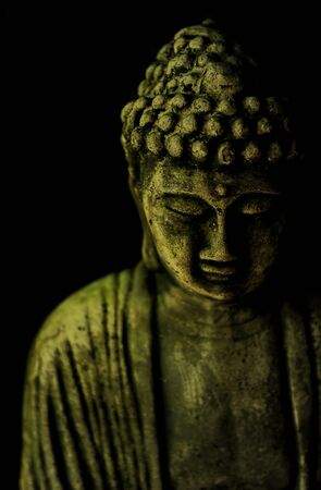 A Buddha statue on a black background Stock fotó