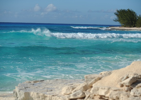 bahamian: Beautiful crystal blue water and waves splashing in the Atlantic Ocean Stock Photo