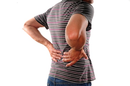 Man holding back who is suffering from lower back pain photo