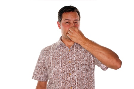 flatulence: Man plugging nose after smelling a very bad stench
