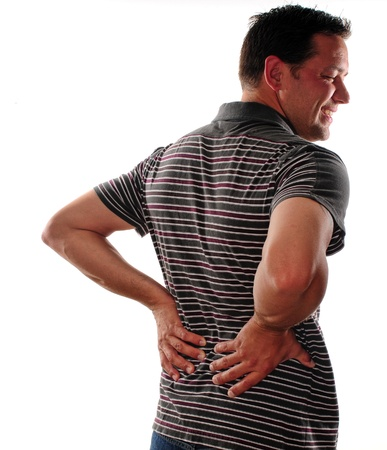 Man holding back because of lower back pain photo