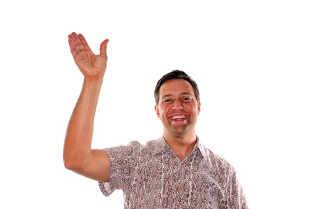 Friendly young man waving hello or goodbye while smiling photo
