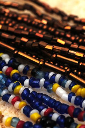 seed beads: Multicolored strands of seed beads on a necklace  Stock Photo