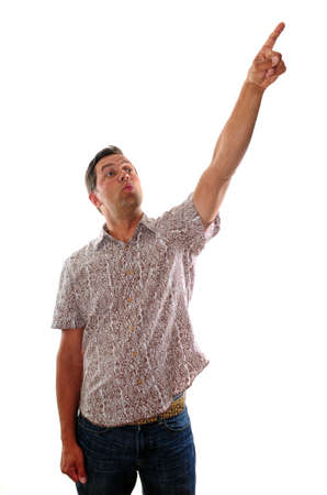 man pointing up: Young man pointing up to an advertisement or copy space