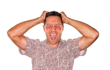 losing control: Stressed man who is losing control and pulling out hair Stock Photo