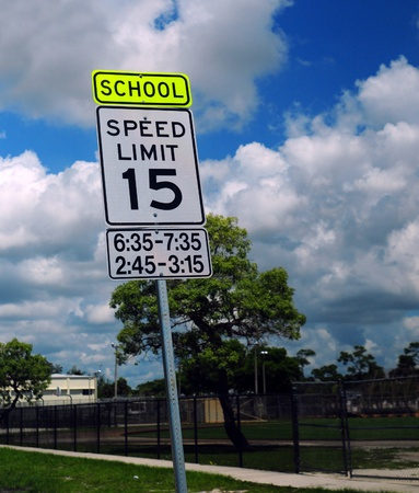 Speed limit sign in a school zone with 15 mph Stock Photo - 13899838
